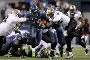 SEATTLE, WA - JANUARY 08: Running back Marshawn Lynch #24 of the Seattle Seahawks runs for a 67-yard touchdown run in the fourth quarter against the New Orleans Saints during the 2011 NFC wild-card playoff game at Qwest Field on January 8, 2011 in Seattle, Washington. (Photo by Otto Greule Jr/Getty Images)